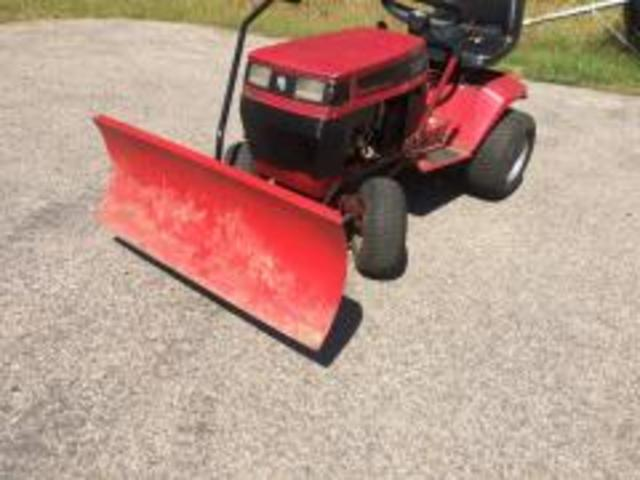 Got the plow on little red!